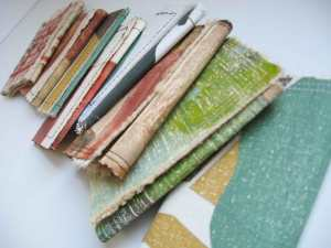 Old canvases that were truly not ever going to be on a wall were ripped from their stretchers a few years ago. But they did inspire these simple trifold card wallets. Simple, fast and funky and upcycled!