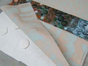 Sandwiching fabric and batting with a bit of modern Trapunto technique (the added circles)