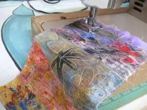 Free stitching adding design lines on pieced fabrics